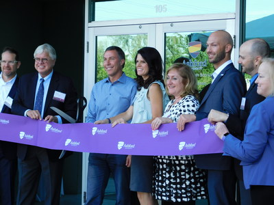 Ribbon cutting ceremony with Dr. Craig Swenson and Mr. Andrew Clark, (second and third from the left, respectively)
