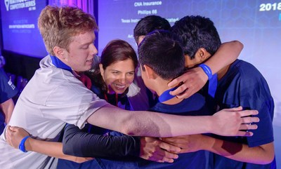 The Texas team hugs their coach after winning first place in the team competition for the third consecutive year at Raytheon MATHCOUNTS® National Competition in Washington, D.C.