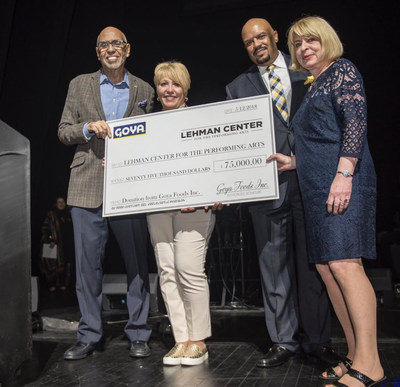 Rafael Toro, Director of Public Relations of Goya Foods presents Lehman Center for the Performing Arts with a $75,000 check for the Latino Concert Series in the Bronx.