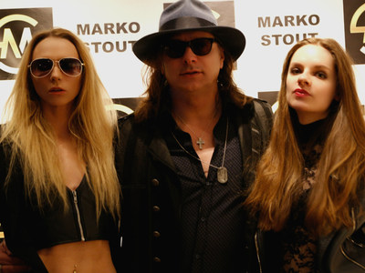 Marko Stout poses with models at his Artifact Gallery exhibition 03/04/18