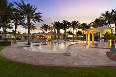 The property's outdoor living areas rival those of a 5-star resort, and are highlighted by a spectacular pool, shown here. More at FLLuxuryAuction.com. (PRNewsfoto/Platinum Luxury Auctions LLC)