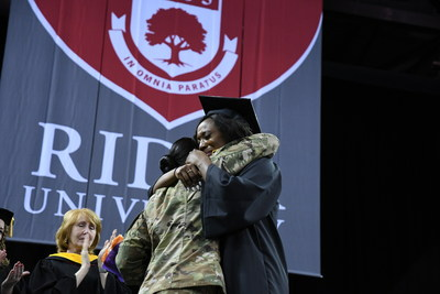 Shamera Smith, deployed in Iraq for the past 10 months, made it home in time to surprise her sister Tyshae Smith at Rider University's commencement ceremony.