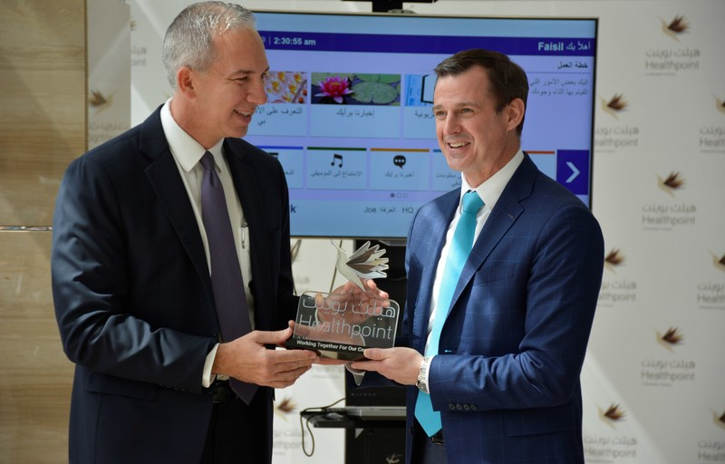 Abu Dhabi, May 15, 2018--Dr. Jose Lopez, CEO, Healthpoint presents a crystal plaque to Michael O'Neil, founder and CEO, GetWellNetwork.