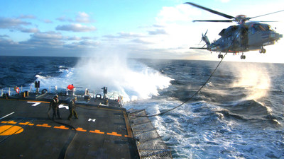 A CH-148 Cyclone helicopter performs a hover in-flight refueling test during sea trials aboard a Royal Canadian Navy Halifax-Class frigate in the North Atlantic.
