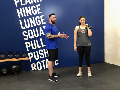 In-Shape master trainer, Damian Weber, using the new MOVE7 system to educate personal trainer Rachel Rodriquez from Manteca as part of In-Shape's investment in team member development and dedication to consistent client experience.