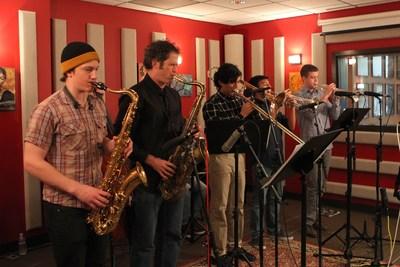 Lynnwood High School jazz band students playing alongside Seattle jazz radio station KNKX.