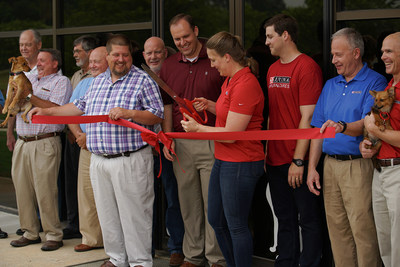 During a ceremony May 19, Rachel Miller, Site Manager of Nestlé Purina's new Hartwell, Georgia facility, prepares to cut the ribbon and officially unveil the company's new 19,000-sq ft distribution center, which will ship Purina dog and cat food to retailers in the southeast region of the U.S. Miller is joined by Purina colleagues, representatives from Hart County and the city of Hartwell, along with adoptable pets from local rescue organizations.