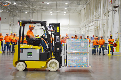 Tommy Walters, operator, unloads the first pallet of pet food into Nestlé Purina's new distribution center in Hartwell, Georgia.