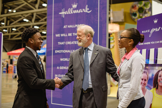 Dave Hall, President, Hallmark Cards, Inc. (center) greets students at the Hallmark booth during the Enactus United States National Exposition Career Fair where companies from around the country vied to attract exceptional talent and, in many cases, offered jobs on the spot.