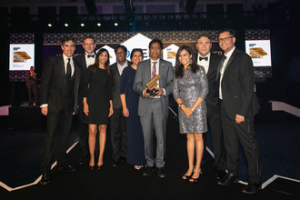 CEO Subhash Makhija, surrounded by members of the GEP leadership team and actor/host Stephen Mangan, accepts procurement technology award in London