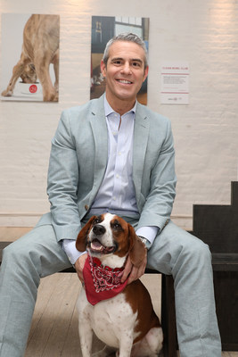 Andy Cohen and Wacha pose for a photo at Gallery 28 by Purina ONE®, which celebrates the brand's ONE Difference Campaign in New York City on Tuesday, May 22. The gallery features never-before-seen photos of Andy and Wacha in their home. Purina ONE is donating $5, up to $28,000, to the Petfinder Foundation for every person who signs up for the Purina ONE 28-Day Challenge between May 22 and June 30 to help more dogs, like Wacha, find their forever homes.