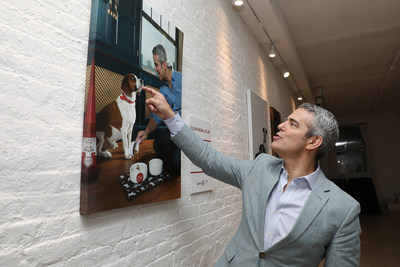 A touching moment; Andy Cohen reacts to a photo at Gallery 28 by Purina ONE®, which celebrates the brand's ONE Difference Campaign in New York City on Tuesday, May 22. The gallery features never-before-seen photos of Andy and Wacha in their home. Purina ONE is donating $5, up to $28,000, to the Petfinder Foundation for every person who signs up for the Purina ONE 28-Day Challenge between May 22 and June 30 to help more dogs, like Wacha, find their forever homes.