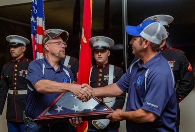 Veteran PepsiCo driver Mike Bedell hands off the American flag to Veteran PepsiCo driver Gary Rochell at the Plano, Texas stop of the 2018 PepsiCo Rolling Remembrance Relay