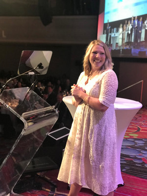 Phoenix Suns fan Whitney Collins accepts the Best in Mobile Fan Experience award on behalf of 15 Seconds of Fame during the 2018 Sports Business Awards in New York City.