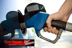 Driver filling up fuel tank at the gas pump