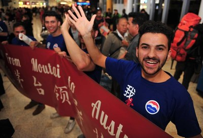 Moutai fans welcome the visiting group to Australia at Sydney Airport
