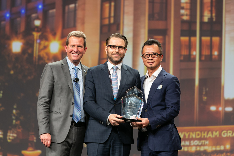 Geoff Ballotti (left), the President and CEO of Wyndham Hotel Group, revealed the winner and presented the trophy to Frank Rudis (middle), the General Manager of Wyndham Grand Xi'an South, and Leo Liu (right), the President and China MD of Wyndham Hotel Group.