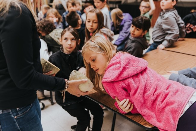 A student at Barnett Elementary School in Ramona, California learns about cantaloupe during the melon taste-test.