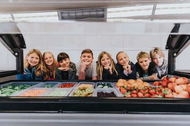 Students at Barnett Elementary School pose with the new salad bar funded by Bayer.