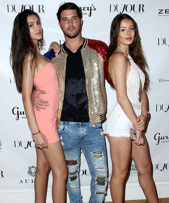 Brooke Korine, Andrew Warren and Nora Gjieli attend DuJour's Annual Memorial Day Kick-Off Party to toast summer cover star Dakota Fanning.