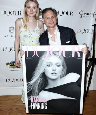 Dakota Fanning and Jason Binn attend DuJour's Annual Memorial Day Kick-Off Party to toast summer cover star Dakota Fanning.