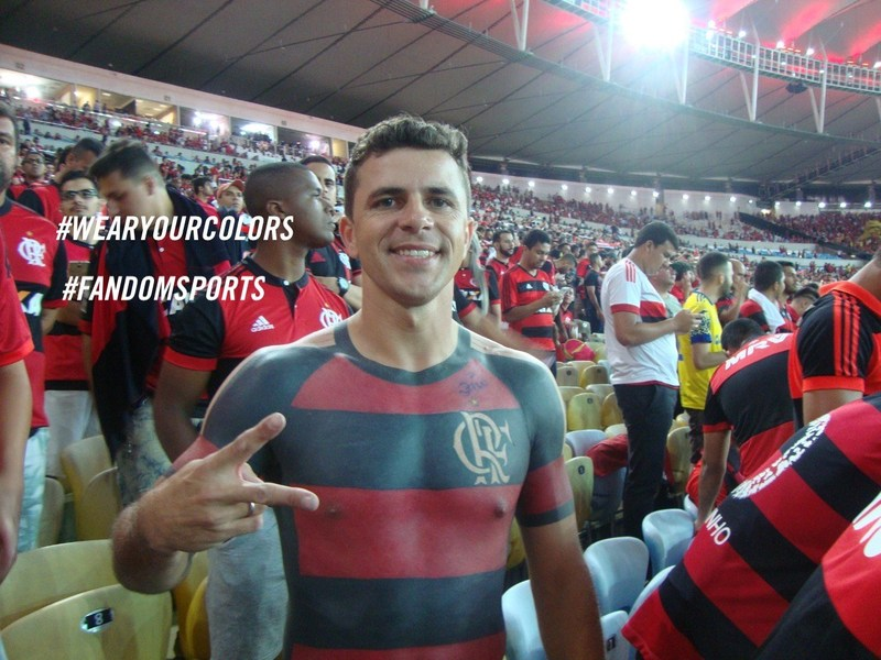 To show his undying love for his favorite soccer team, Mauricio endured years of visits to a tattoo artist in Brazil to permanently emblazon the Flamengo colors on the front and back of his torso.  His unparalleled devotion and incredible body art helped to inspire FANDOM SPORTS' new #WearYourColors campaign.