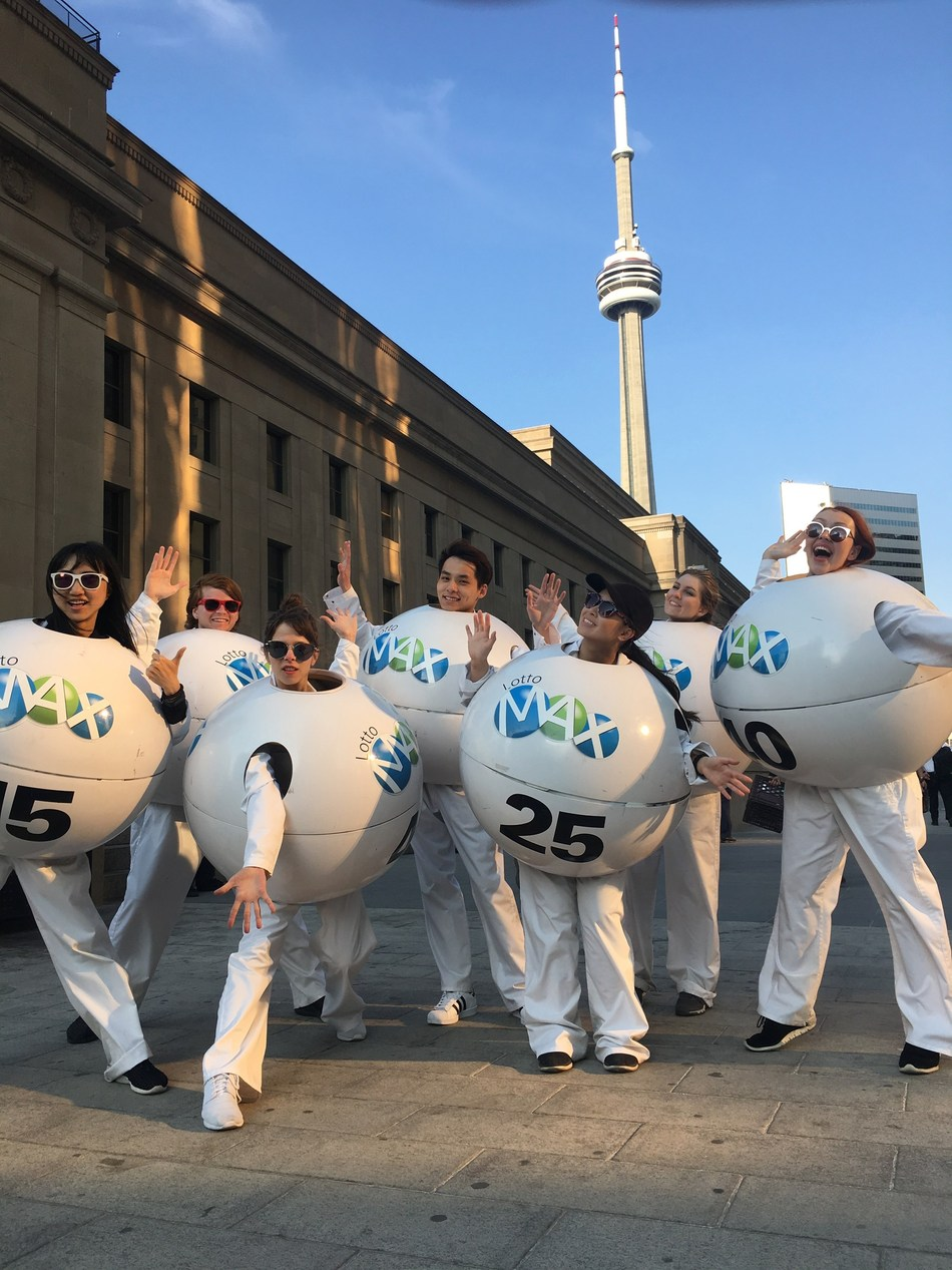 The LOTTO MAX Balls spread the word about the record-smashing $60 million jackpot and 50 $1 million MAXMILLIONS prizes up for grabs in Friday's LOTTO MAX draw. (CNW Group/OLG Winners)