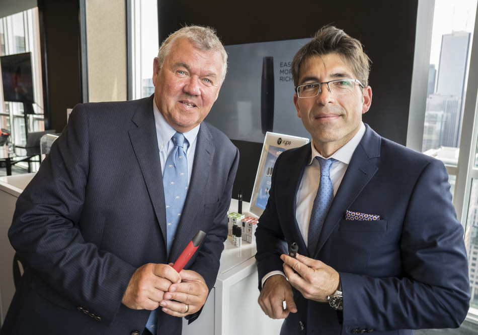 Chris Proctor, Chief Scientific Officer of British American Tobacco (BAT), left, joins Jorge Araya, President and CEO of Imperial Tobacco Canada, subsidiary of BAT, right, at a public event in Toronto, Thursday, May 31, 2018, to introduce the company's vision of transforming tobacco and announce a national roll-out of Vype vaping products, potentially less risky alternatives to combustible cigarettes now available in Canada. (CNW Group/Imperial Tobacco Canada)