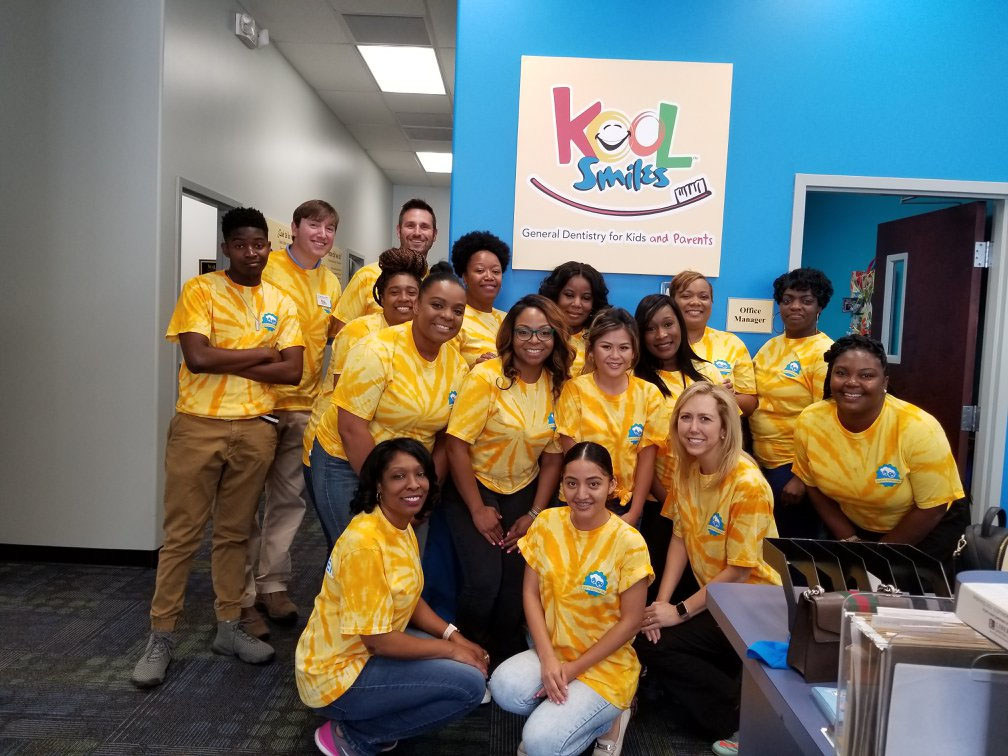 Volunteer dentists and staff from Kool Smiles were all smiles and ready to provide free care to local children in need during their fourth annual Sharing Smiles Day.