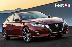 Red 2019 Nissan Altima parked on gravel at sunset