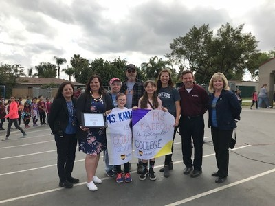 Kristin Karrow, teacher at a No Excuses University school and recipient of a full scholarship to Ashford University, with her family, principal, vice principal, and Ashford University representatives.