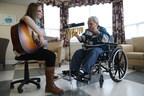 Deborah Hawksley (L) and Ethel Picco enjoying music in the lounge room at St. Patrick's Mercy Home in St. John's, Newfoundland. Photo credit: Paul Daly (CNW Group/Canadian Foundation for Healthcare Improvement)