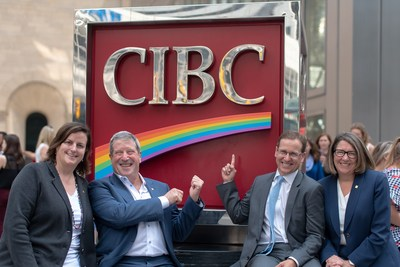 Nancy Bramm, Vice President, Communications at CIBC, and Executive Sponsor of the bank's Pride Network was joined by members of CIBC's Inclusion & Diversity Leadership Council in celebrating the start of Pride Month. In addition to raising the Pride Flag in front of the bank's Toronto headquarters at King and Bay streets, the bank also proudly revealed new rainbow signage to demonstrate its ongoing commitment to LGBT+ clients and employees. (CNW Group/CIBC)