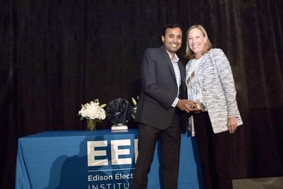 Think Power Solutions' Hari Vasudevan receiving the award from EEI Chairman Pat Vincent-Collawn