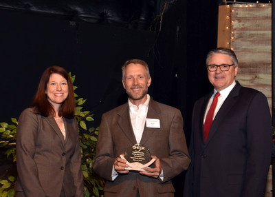 Think Power Solutions' Brian Flage receiving the Oncor Rising Star Supplier award from Oncor COO Jim Greer and Vice President Ellen Buck