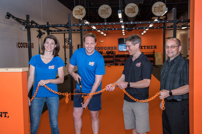 Tough Mudder Bootcamp Burlington V.I.P.'s participate in a commemorative ribbon cutting ceremony (pictured left to right: Tough Mudder SVP Cathrin Bowtell; Tough Mudder CEO/Founder, Will Dean; Burlington Franchisee Henry Pott; and Burlington Area Chamber of Commerce President, Rick Parker).
