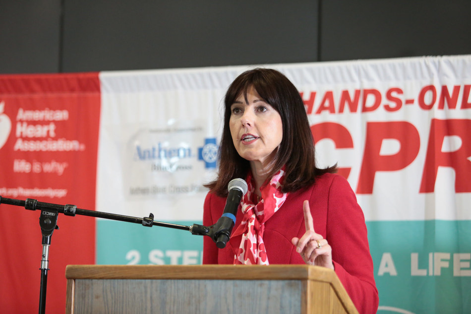 Kathy Rogers, American Heart Association Executive Vice President for the Western States region, delivers remarks at Oakland International Airport where two American Heart Association Hands-Only CPR training kiosks debuted. A kiosk supported by Anthem Blue Cross Foundation is located near Gate 8, Terminal 1. The second kiosk supported by Chevron Corporation is near Gate 27, Terminal 2.