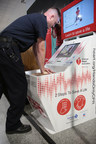 An Oakland International Airport Fire Department employee uses the Hands-Only CPR training kiosk supported by Anthem Blue Cross Foundation that debuted at Oakland International Airport. The kiosk provides Hands-Only CPR training in five minutes.