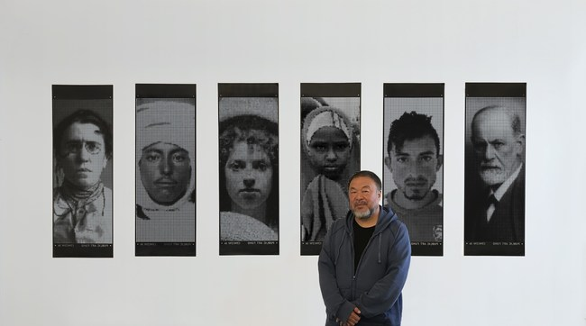 """Artist Ai Weiwei with artworks: Banner 51, Banner 2, Banner 13, Banner 200, Banner 90, Banner 50; CNC laser cut vinyl 17"""" x 48."""" Courtesy, Public Art Fund, NY."""
