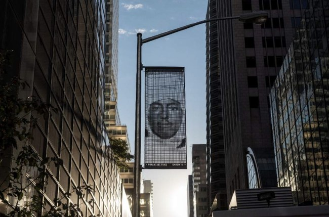 """Ai Weiwei, Banner 2 installed on 55th Street outside Trump Tower as part of the citywide exhibition """"Good Fences Make Good Neighbors,"""" presented by Public Art Fund, October 12, 2017-February 11, 2018. Photo: Timothy Schenck, Courtesy Public Art Fund, NY"""