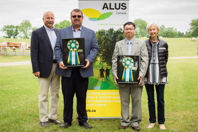 ALUS Canada and The W. Garfield Weston Foundation today presented two Innovation Awards, for producing and for researching ecosystem services on farms and ranches. From L to R: Bryan Gilvesy, CEO of ALUS Canada; Joe Csoff, winner of the 2018 ALUS Canada Producer Innovation Award; Dr. Wanhong Yang, winner of the 2018 Weston Family Ecosystem Innovation Award; Mrs. Camilla Dalglish, Director, The W. Garfield Weston Foundation. Photo: Splash Photography (CNW Group/ALUS Canada)