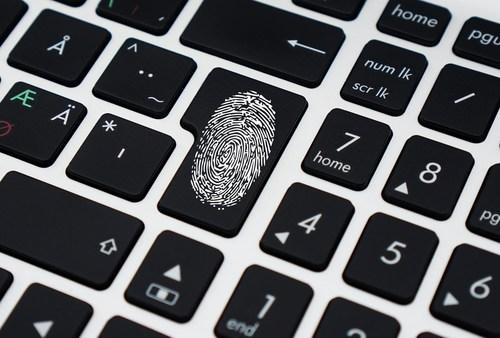 Image of fingerprint on keyboard depicting evidence of cyber attack.