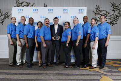 Edison Electric Institute (EEI) President Tom Kuhn (center) presents employees of Florida Power & Light Company (FPL) with a 2018 Emergency Assistance Award for Puerto Rico Power Restoration during EEI's annual convention in San Diego, June 5, 2018. FPL's team of more than 400 men and women worked for nearly 200 days, restoring power to approximately 30,000 homes in the aftermath of Hurricane Maria. Photo credit: EEI.
