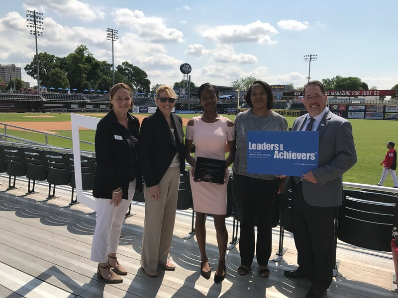 (l to r) Comcast Vice President, External Affairs Lisa Birmingham; Comcast Director, Community Impact Beth Crow; $10,000 Comcast Founders Scholarship Recipient Jahnea Pressley; Heather Pressley; and Comcast Senior Director Todd Eachus at Comcast's Leaders & Achievers Scholarship Program event at FNB Field in Harrisburg.