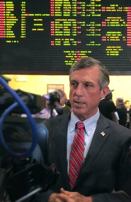 Governor John Carney of the 'First State' makes the first bet to launch Delaware Lottery's expansion to full-scale sports betting, powered by Scientific Games, the Lottery's longtime systems and sports betting technology provider.