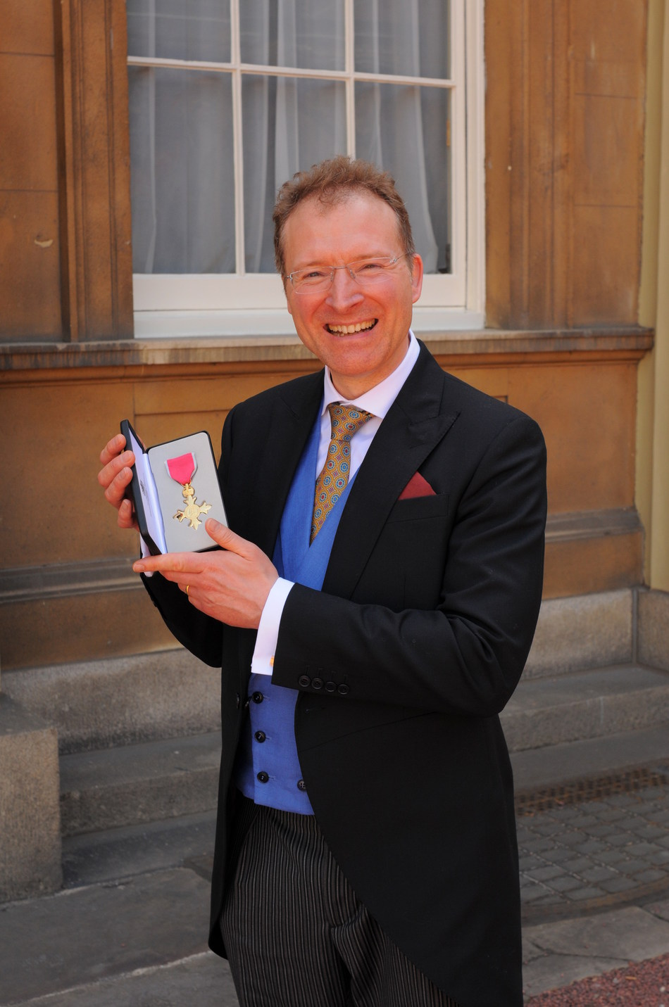 Dr Richard Wilson Receives OBE for Services to the Video Games Industry at Buckingham Palace (PRNewsfoto/TIGA)