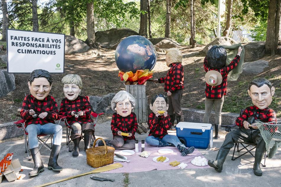 Faites face à vos responsabilités climatiques (Groupe CNW/OXFAM-QUEBEC)