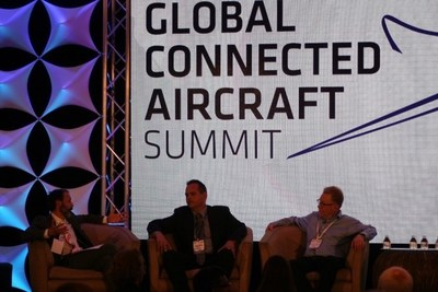 Alex Preston, inflight editor, HMG Aerospace, left, Jason De Mos, vice president of business development and compliance, Airborne Wireless Network, center, and Dave Colbert, senior vice president flight operations, XOJET, discuss market dynamics and the unmet global demand for airborne connectivity.  Other participants (not pictured) included representatives from Rockwell Collins, Honeywell Aerospace, and Iridium FlytLINK/Thales Avionics. (photo by Michael Warren, CEO, Airborne Wireless Network)