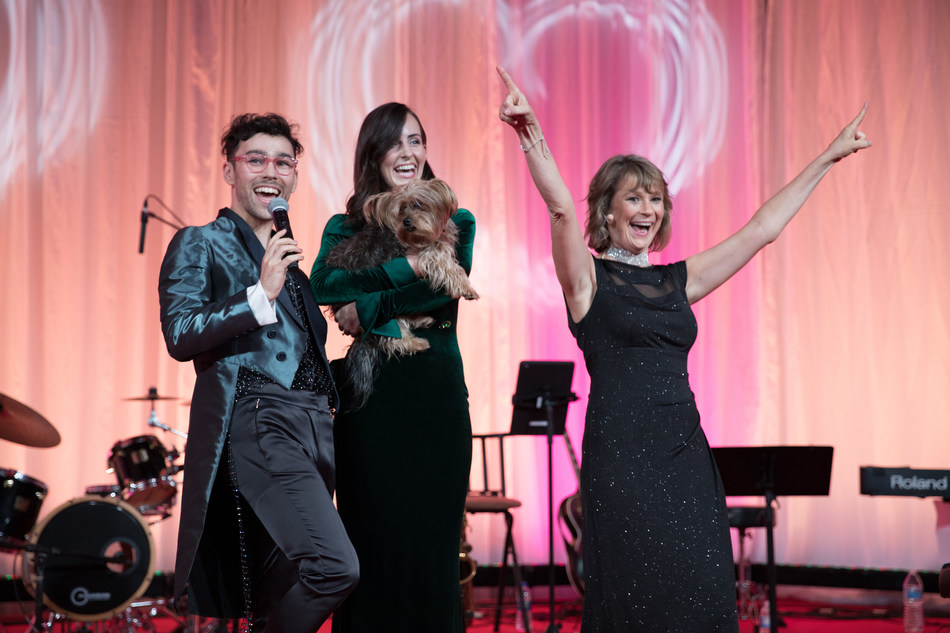 Max on stage with his wife Emily, adopted dog Wink and Susanne Kogut president of the Petco Foundation following his performance to kick off the Lifesaving Awards.