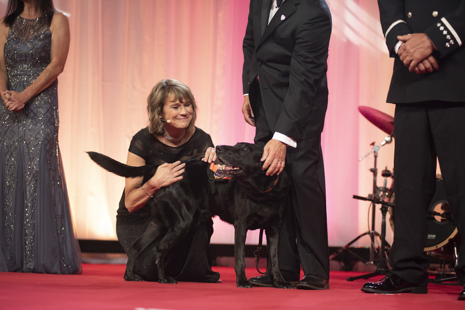 Petco Foundation president Susanne Kogut with a dog from the National  Disaster Search Dog Foundation during the 2018 Petco Foundation Awards Gala.
